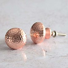 A Pair of Pushka Home Copper Hammered Rose Gold
