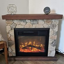Electric fireplace finished with stone effect and