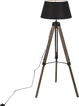 Industrial floor lamp on wooden tripod with black
