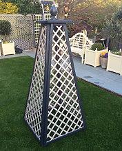 Obelisk with acorn