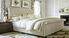 Spring Well, Sleigh style bed with scrolled ends