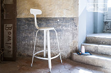 White bar stool with rivets