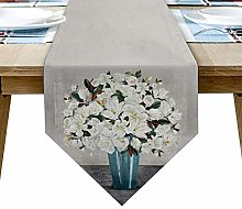White Magnolia Flower Bouquet and Blue Vase Table