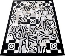 Zerimar Cowhide Area Rug, 66x94 in, Area Rugs for